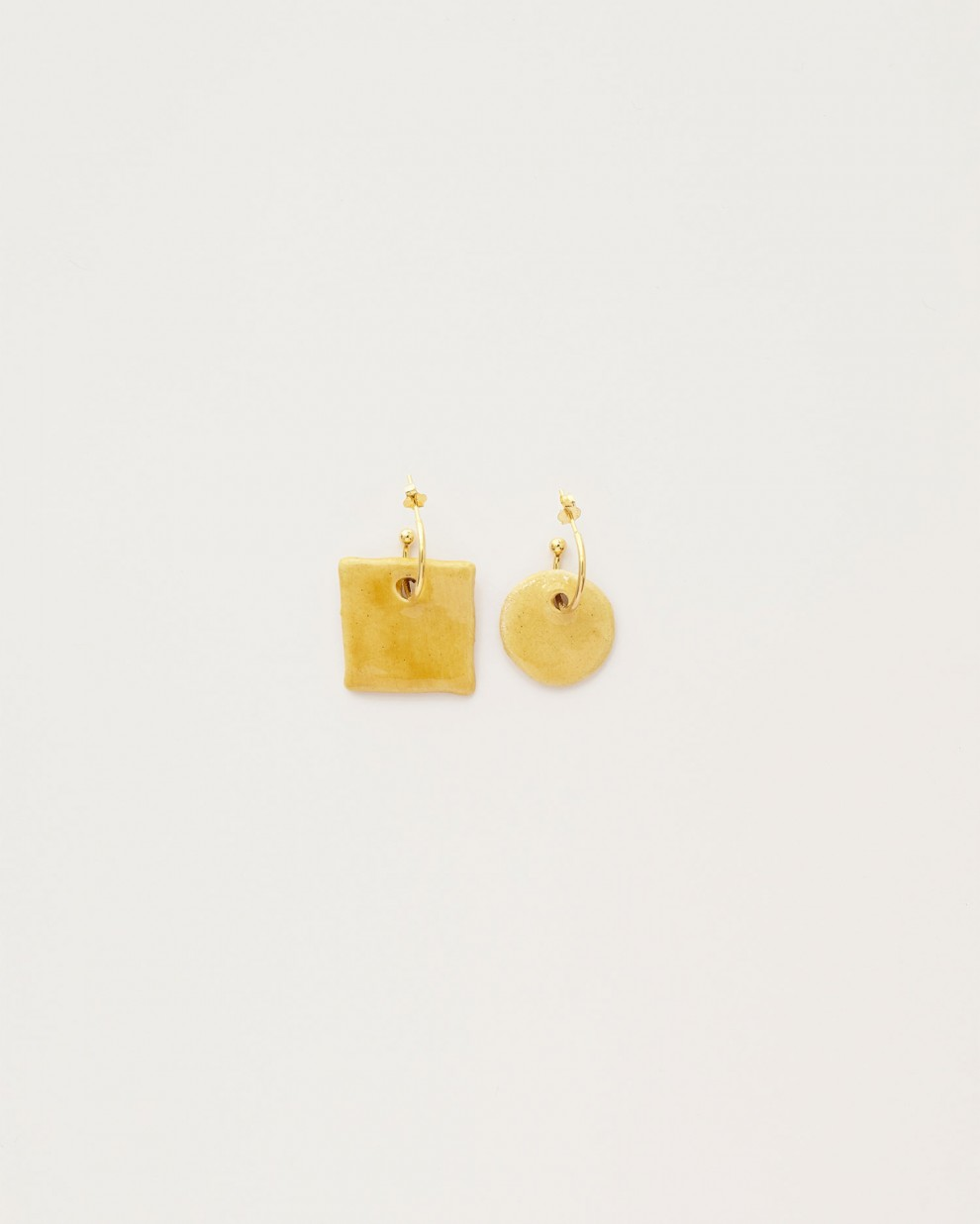 Asymmetric yellow earrings
